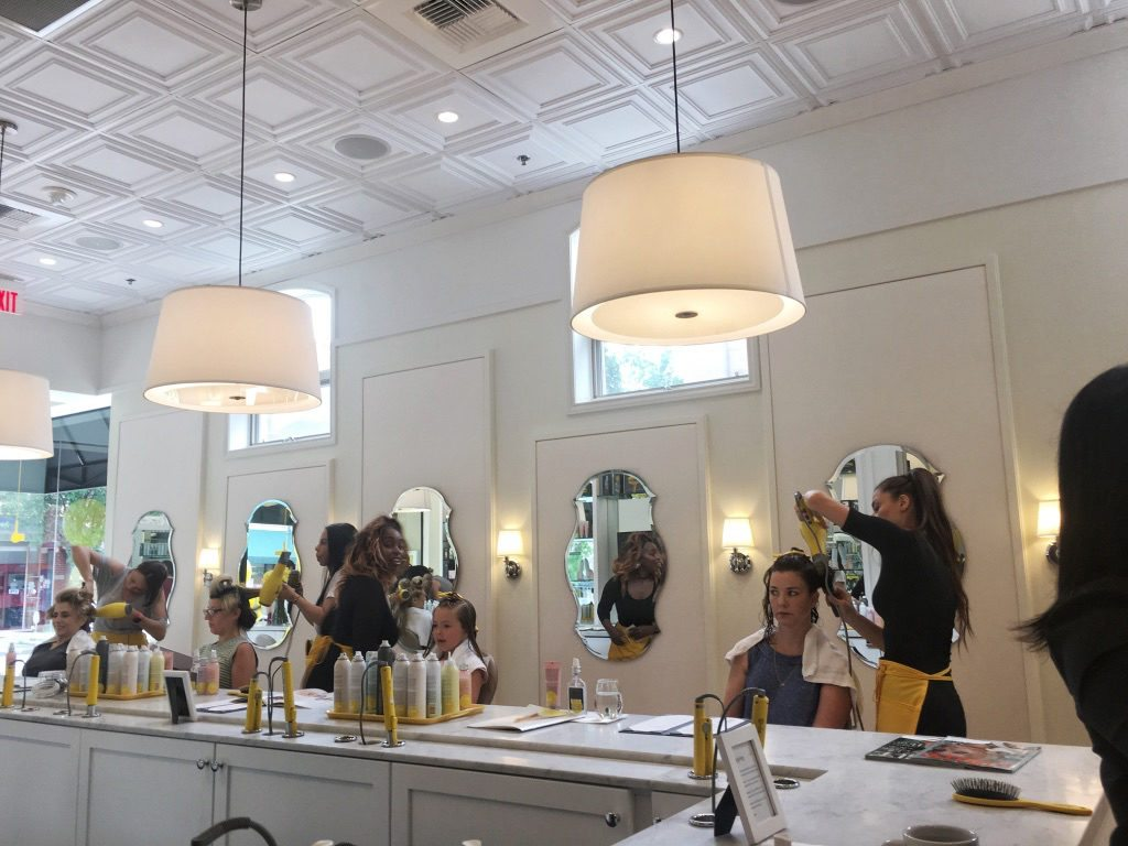 Stylists giving the girls blowouts at DryBar Summit